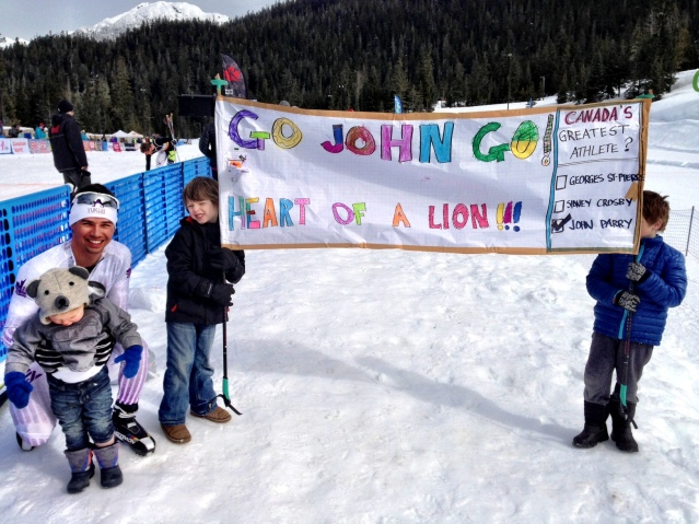 The Boys With Their Big Cousin and the Sign They Cheered Him On With